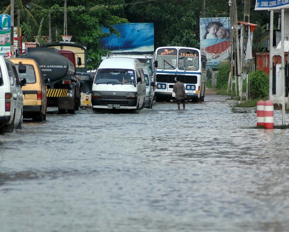 Motorists navigate a flooded stretch of road in the town of Ragama, just north of Colombo. Credit: Amantha Perera/IPS