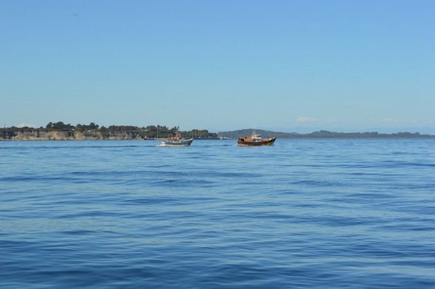 Fishing boats crossing the Chacao Channel off the coast of the Greater Island of Chiloé in Chile's southern Los Lagos region. Credit: Claudio Riquelme/IPS