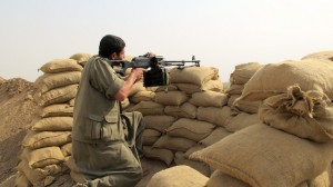 A PKK fighter holds his position in Nouafel, an Arab village west of Kirkuk in northern Iraq. Credit: Karlos Zurutuza/IPS