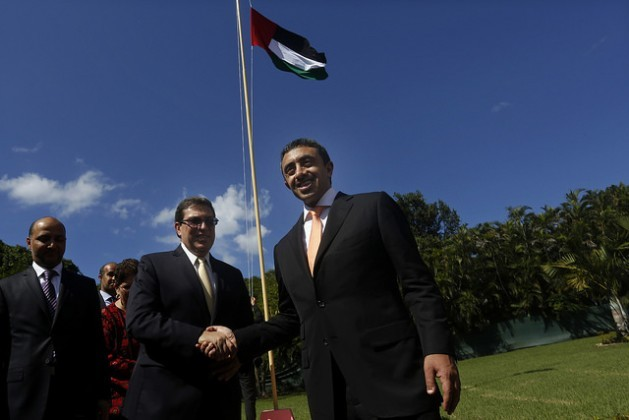 The United Arab Emirates foreign minister, Abdullah bin Zayed Al Nahyan, shakes hands with his opposite number in Cuba, Bruno Rodríguez, after raising the UAE flag at the opening of the Emirati embassy in Havana on Oct. 5, 2015. Credit: Jorge Luis Baños/IPS