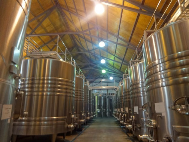 Storage tanks in a winery in the western Argentine province of Mendoza. The distinctive colour of the wine made from malbec grapes, the main kind produced by local winemakers, is starting to change due to the impact of climate change. Credit: Fabiana Frayssinet/IPS