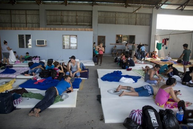 A group of Cubans wait in a shelter opened by the authorities in the town of La Cruz in the northwestern Costa Rican border province of Guanacaste. Credit: National Risk Prevention and Emergency Response Commission of Costa Rica