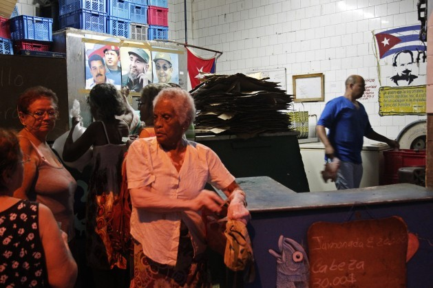 A group of women wait their turn to buy rationed food that is sold at subsidised prices, at a government shop in Havana, Cuba on Nov. 21, 2015. Credit: Jorge Luis Baños/IPS