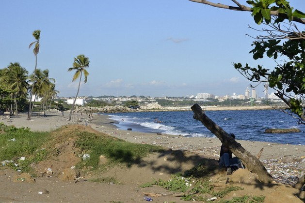 A view of Gringo beach and, in the background, the city of Bajos de Haina, the Dominican Republic's main industrial hub and port, and the third-most polluted city in the world. Credit: Dionny Matos/IPS