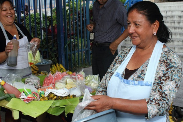 María Elena Rodríguez, 54, makes a living selling fruit at a street stand in San Salvador. She forms part of El Salvador's informal economy, where workers are not covered by the pension system and women are a majority. Credit: Edgardo Ayala/IPS