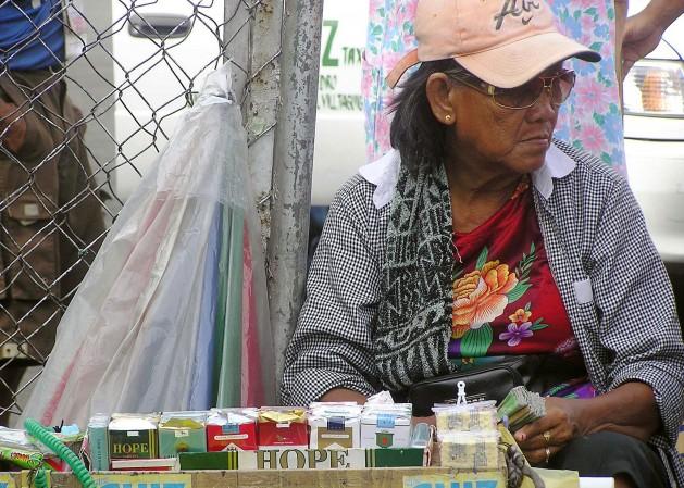 A cigarette vendor in Manila sells a pack of 20 sticks for less than a dollar. / Credit:Kara Santos/IPS