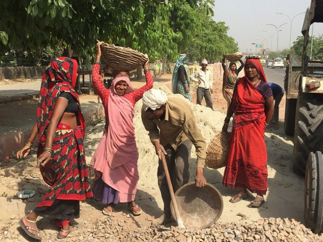 Many Bangladeshi migrants and those from coastal Indian towns take up menial jobs in the construction industry and live in slums. Credit: Neeta Lal/IPS