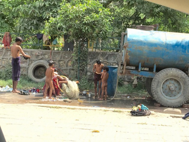 Millions of Indian women struggle to bathe their children and collect water for household chores. Most poor do not get a home supply, increasing their reliance on erratic government-run water tankers. Credit Neeta Lal/IPS