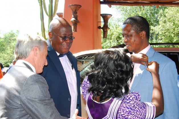 WFO President Evelyn Nguleka pinning the WFO emblem on Zambian President Edgar Lungu. Credit: Friday Phiri/IPS