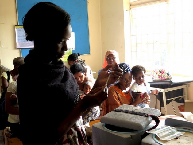 Women wait to immunize their children at the Kisugu Health Centre in Kampala, Uganda, where free vaccinations take place. The nurse in the foreground is Betty Makakeeto. Credit: Amy Fallon/IPS