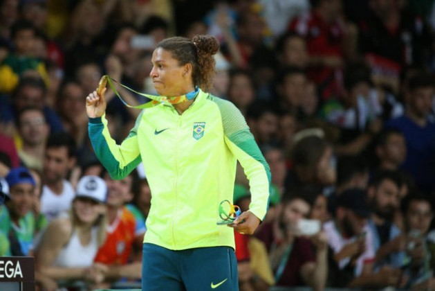 """Judoka Rafaela Silva, who won Brazil's first medal – gold - on Aug. 8, had received racial slurs like """"monkey that should be in a cage"""" when she was disqualified from the London 2012 Games; now she is fa heroine. Credit: Roberto Castro/Brasil2016"""