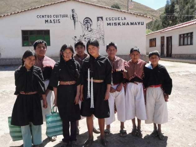 Indigenous schoolchildren standing in front of the Miskhamayu school in an isolated part of Bolivia's Andes highlands. Many students walk 12 km or more every day, along steep roads and trails from their remote villages, to get to school. Credit: Marisabel Bellido/IPS