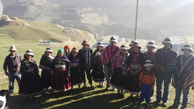 Members of the 16 rural families who refuse to abandon their homes in the village of Taquiruta until the company running the Las Bambas mine compensates them fairly for the loss of their animals, pens and houses. In the background can be seen the biggest mine in Peru. Credit: Milagros Salazar/IPS