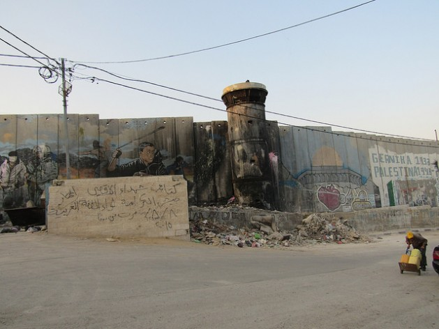 """An eight-meter-high """"security wall"""" borders part of the Aida refugee camp, 1.5 km north of the city of Bethlehem. Credit: Fabiola Ortiz/IPS"""