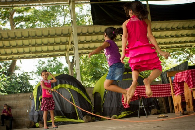 Girls skip rope in the camp where they are staying in the town of Caluco, in western El Salvador, in makeshift accommodations on a basketball court. Dozens of families have fled from the neighbouring rural community of El Castaño, owing to the criminal violence and threats from gangs.