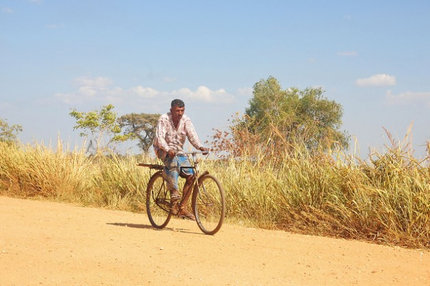 A man rides his bicycle through a dusty village in the Mahavellithanne area, about 350 km northeast of Sri Lanka's capital Colombo, where daytime temperatures were hitting 38C this week. Credit: Amantha Perera/IPS