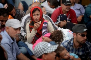 A displaced woman waiting in a transit camp in Gevgelja, Former Yugoslav Republic of Macedonia. Photo: Dejan Dokuzovski/UNDP