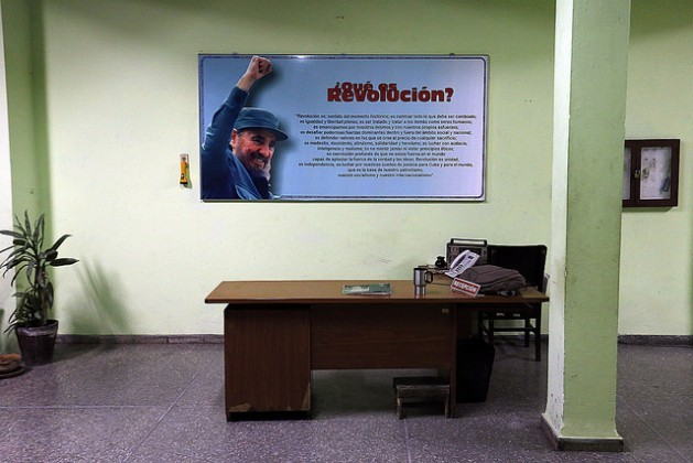 A picture of Fidel Castro behind an empty desk in a city government office in Havana on Saturday Nov. 26, a few hours after the death of the leader of Cuba's revolution, at age 90. Credit: Jorge Luis Baños/IPS