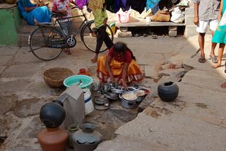 A woman at a public water tank in a Bangalore slum. Credit: Malini Shankar/IPS