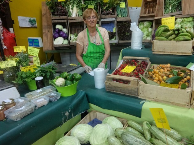 Agroecological farmer Alicia Della Ceca at her stand in El Galpón, in the neighborhood of Chacarita in the Argentine capital. In the organic producers market, she sells directly to consumers what she and her two children grow on their 3.5-hectare farm. Credit: Fabiana Frayssinet/IPS