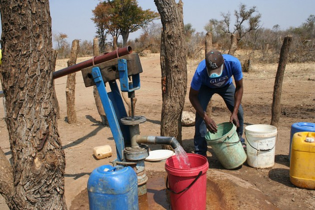 Curbing illicit financial flows will free finances for development projects like the provision of safe drinking water. A man collecting water at a government-funded borehole in Southern Zimbabwe. Credit: Busani Bafana/IPS