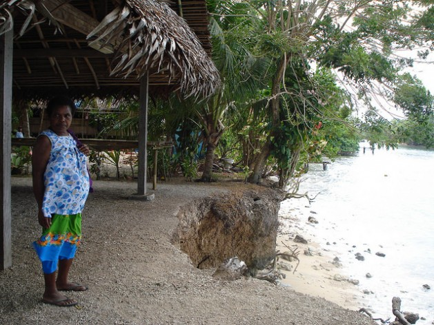 Higher tides and coastal erosion are encroaching on homes and community buildings in Siar village, Madang Province, Papua New Guinea. Credit: Catherine Wilson/IPS