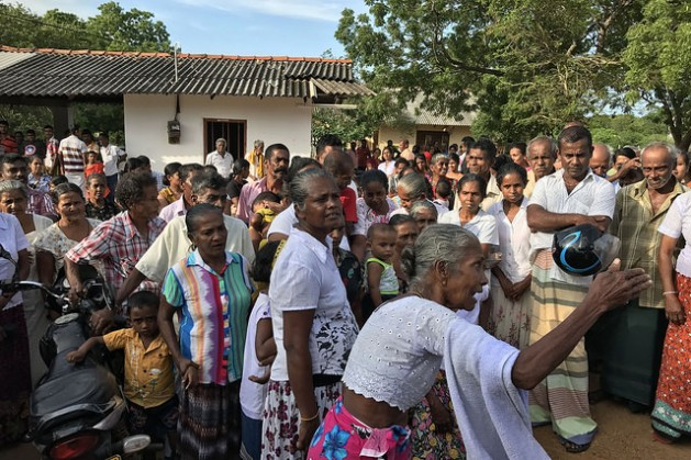 """""""Over our dead bodies."""" Villagers in Beragama, Sri Lanka protest to prevent government surveyors from carrying out mapping due to fears of losing their land. Credit: Sanjana Hattotuwa/IPS"""