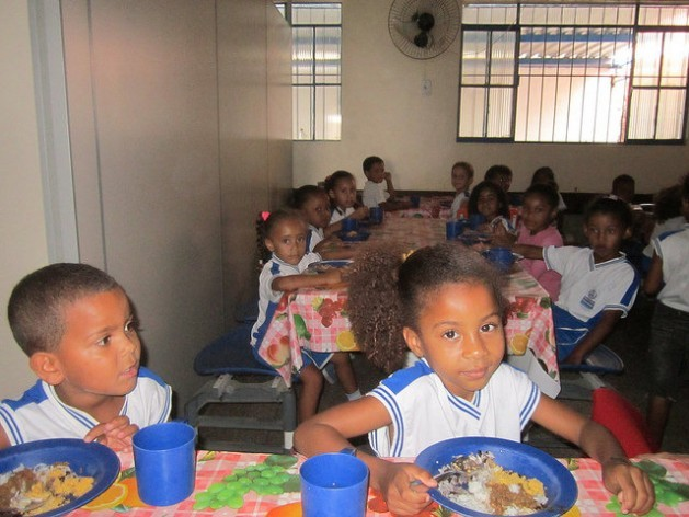 Children eat lunch at a school in the state of Rio de Janeiro, Brazil, in a community where most children live in poverty, but thanks to the synergy between family farming and school meals, they have managed to eliminate malnutrition among the student body. Credit: Mario Osava/IPS