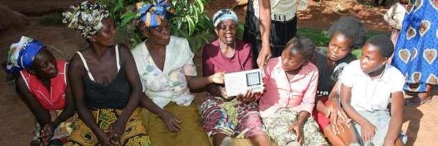A group of women in Africa listen to their favorite radio program. Photo courtesy UNESCO.