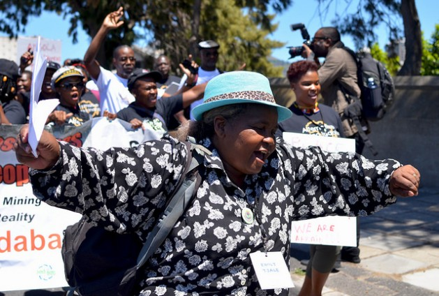 A delegate from the Alternative Mining Indaba dances during a protest march on Feb. 8, 2017. About 450 representatives of civil society mining-affected communities attended the conference in Cape Town. Credit: Mark Olalde/IPS