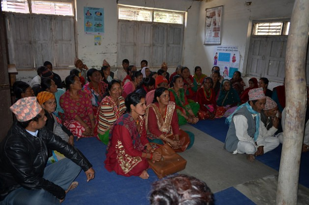 Juna Bhujel (looking at the camera) at the Mankha VDC office to complain about non-payment of disaster relief funds to reconstruct housing. She lost her home in Nepal's April 2015 earthquake. Credit: Renu Kshetry/IPS