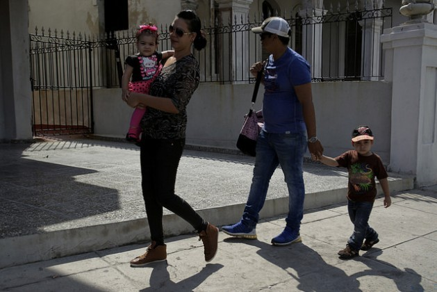 A Cuban family walks down a street in the neighborhood of Vedado, in the Plaza de La Revolución municipality, in Havana, Cuba, where just 49 per cent of children grow up in households with both parents. Credit: Jorge Luis Baños/IPS