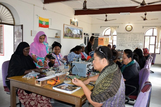 Engineer Magan Kawar (wearing pink), who left school after third grade, teaches a class of international students in solar technology. Kawar has trained 900 women from over 20 countries. Credit: Stella Paul/IPS