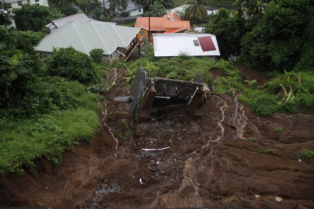 Torrential rains from trough systems in St. Vincent and the Grenadines in November 2016 resulted in landslides like this one, which swept one structure away and threatened nearby houses. Credit: Kenton X. Chance/IPS
