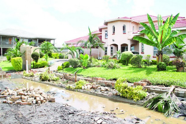 Even luxury homes in the Zimbabwean capital Harare were not spared by the raging floods of early 2017, perpetuating hunger in the Southern African nation after El Nino ravaged crops nationwide. Credit: Jeffrey Moyo/IPS