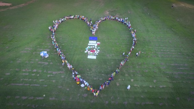 Marchers form a heart shape at the 2015 climate marc, in Port-of-Spain, Trinidad, organised by youth activists from IAMovement. Credit: IAMovement