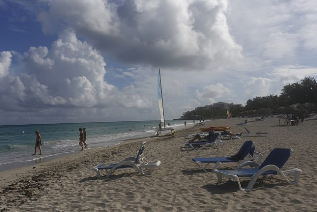 Tourists enjoy the beach in the international resort of Varadero, in western Cuba. Scientists say the erosion of sandy ecosystems in the Greater Caribbean - which have a high economic value and are a protective barrier for life inland - is irreversible. Credit: Jorge Luis Bolaños/IPS