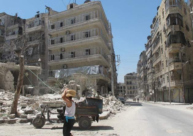 World Humanitarian Day / Syrian boy brings bread back from underground bakery in severly damaged opposition-held area of Aleppo. August 2014. photo credit Shelly KittlesonIPS