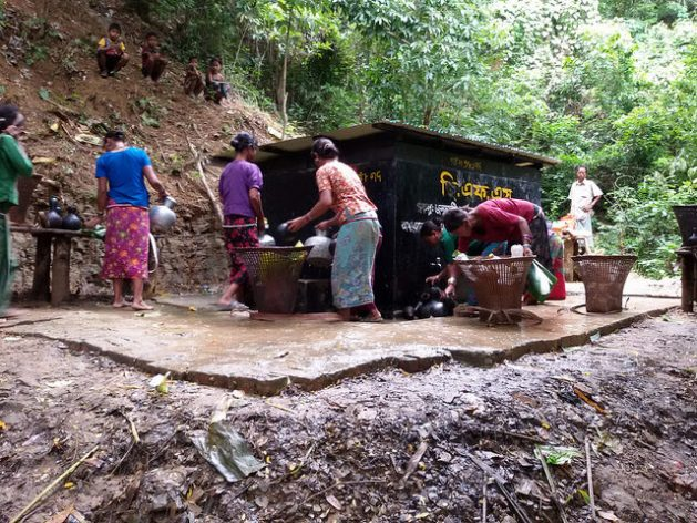 Ethnic women collect drinking water from a water plant in Chittagong Hill Tracts, Bangladesh. Credit: Rafiqul Islam/IPS
