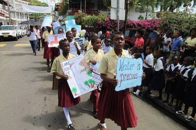 World Water Week - Primary School students in Grenada are seen here working together to promote awareness on water conservation on World Water Day. Credit: Global Water Partnership