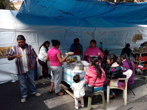 A community of 35 Nahñú indigenous families, from the central state of Querétaro, set up a camp in front of the old building that they occupied in the center of Mexico City, which was heavily damaged by the Sept. 19 earthquake. In the photo can be seen the tent that serves as their kitchen and dining room. Credit: Emilio Godoy / IPS