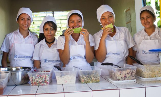 Students at the Pepenance Canton School, in the municipality of Atiquizaya, in western El Salvador, wait for lunch to be prepared with local recipes and products purchased from farmers in the surrounding community, as part of the Sustainable Schools project's healthy meals programme. Credit: Edgardo Ayala/IPS