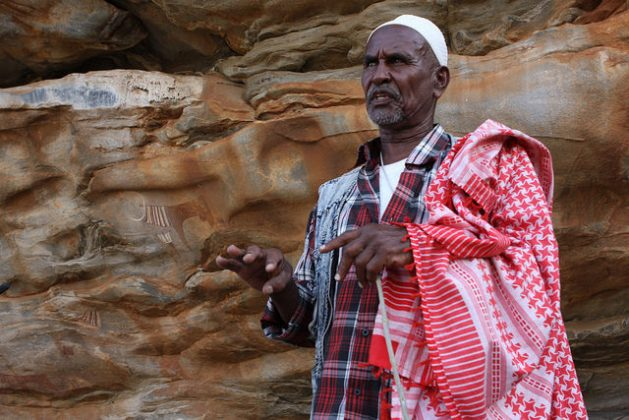 """""""When I was a boy we thought these pictures had some sort of devilish connection,"""" says 57-year-old Musa Abdi, who has spent his whole life around Las Geel and these days helps look after the site. Credit: James Jeffrey/IPS"""
