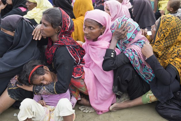 Women and children who escaped the brutal violence in Myanmar wait for aid at a camp in Bangladesh. Credit: Parvez Ahmad/IPS