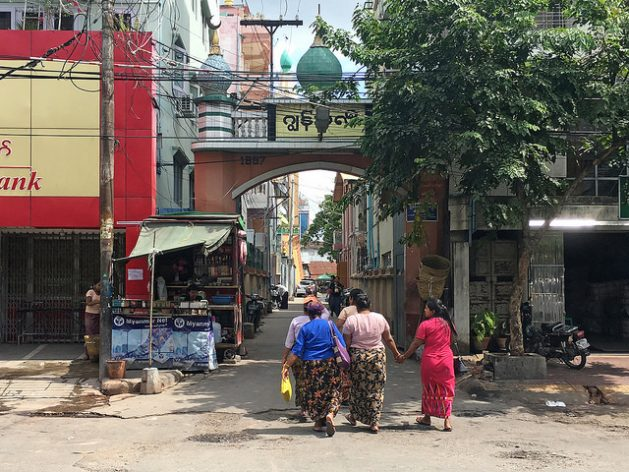 The propaganda of the government and hostility of Buddhist nationalists are not exclusively reserved for the Rohingya in Rakhine - The entrance to the gated community of Joon, Myanmar. With tensions between Muslims and Buddhists rising, the gates are closed at night. Credit: Pascal Laureyn/IPS