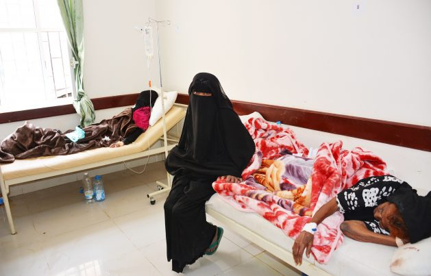 Fatima Shooie sits between her 85-year-old mother and 22-year-old daughter who are both receiving treatment for cholera at a crowded hospital in Sana'a. Credit: WHO/S. Hasan