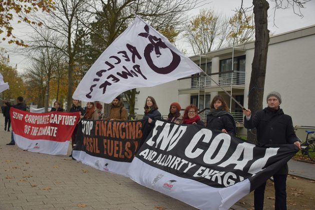 Protesters at the COP3 in Bonn demand the complete phase-out of coal, a major contributor to carbon emissions. Credit: Stella Paul/IPS