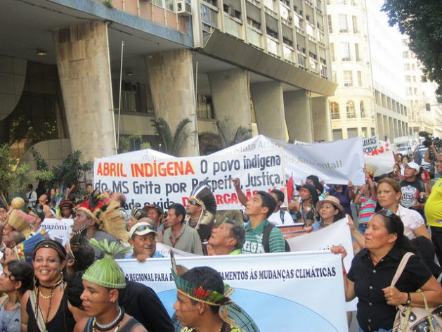 Brazilian Indigenous people during one of their regular protests in Rio de Janeiro demanding the demarcation of their lands and to be taken into account in environmental and climate measures. Credit: Mario Osava / IPS