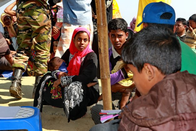 Newly arrived Rohingya people wait at an army camp in Sabrang in Teknaf on Nov. 29, 2017 before being shifted to a camp in Cox's Bazar. Credit: Farid Ahmed/IPS