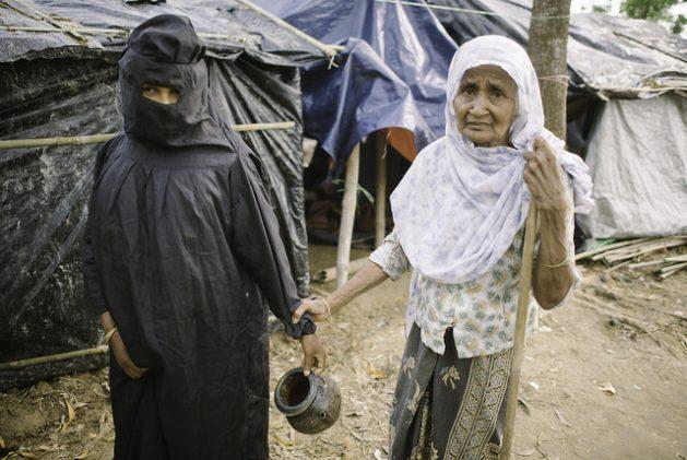 Rohingya women of Balukhali camp embarking on the trek to the toilets. Credit: Umer Aiman Khan/IPS